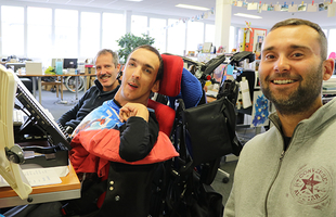 Photo: LIFEtool Researcher Michael and Stefan with a young man in a wheelchair testing a website.