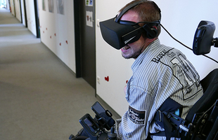 Photo: Young man in wheelchair with VR glasses