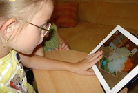 Photo: Girl operates an iPad