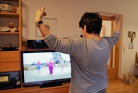 Photo: Senior does gymnastics in front of TV