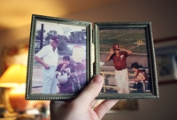 Photo: Picture frame with two pictures of a senior citizen playing Baseball with a child.